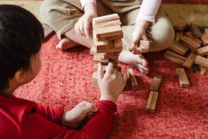 children playing jenga